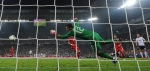 Portugal's goalkeeper Rui Patricio fails to stop a goal scored by German forward Mario Gomez (unsen) during the Euro 2012 championships football match Germany vs Portugal on June 9, 2012 at the Arena Lviv. AFP PHOTO / PATRIK STOLLARZ