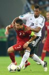 TOPSHOTS Portuguese forward Cristiano Ronaldo (L) vies with German defender Jerome Boateng during  the Euro 2012 championships football match Germany vs Portugal  on June 9, 2012 at the Arena Lviv. AFP PHOTO / JEFF PACHOUD