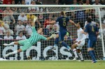 English goalkeeper Joe Hart (L) dives during the Euro 2012 championships football match France vs England on June 11, 2012 at the Donbass Arena in Donetsk. AFP PHOTO/ FRANCK FIFE