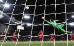Portuguese goalkeeper Rui Patricio jumps for the ball during the Euro 2012 football championships match Portugal vs. Netherlands on June 17, 2012 at the Metalist stadium in Kharkiv.    AFP PHOTO / FILIPPO MONTEFORTE