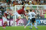 Danish midfielder William Kvist (C) goes airborne next to German defender Philipp Lahm during the Euro 2012 football championships match Denmark vs. Germany, on June 17, 2012 at the Arena Lviv in Lviv.     TOPSHOTS/AFP PHOTO/ANNE CHRISTINE POUJOULAT
