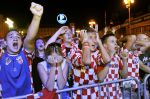 Croatian football fans react while watching Euro 2012 group C football championships match between Croatia and Spain on June 18, 2012 at capital Zagreb's main square. Several thousand people gathered at the Zagreb's main square to watch Croatia's crucial match on a giant screen, erected at an improvised stage, live broadcast of the match played in Gdansk, Poland. Croatia lost 0 1 and did not qualified for the quarterfinal.  AFP PHOTO/ Hrvoje POLAN