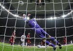 TOPSHOTS  Portuguese forward Cristiano Ronaldo (C) heads to score past Czech goalkeeper Petr Cech during the Euro 2012 football championships quarter final match the Czech Republic vs Portugal on June 21, 2012 at the National Stadium in Warsaw.       AFP PHOTO / ANNE CHRISTINE POUJOULAT