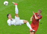TOPSHOTS   Portuguese forward Cristiano Ronaldo (L) tries to score despite Czech defender David Limbersky during the Euro 2012 football championships quarter final match between the Czech Republic and Portugal on June 21, 2012 at the National Stadium in Warsaw. AFP PHOTO / GABRIEL BOUYS
