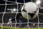 Greece's goalkeeper Michalis Sifakis (top) fails to save a goal by Germany's Sami Khedira during their Euro 2012 quarter final soccer match at the PGE Arena in Gdansk June 22, 2012.                     REUTERS/Pascal Lauener (POLAND    Tags: SPORT SOCCER)