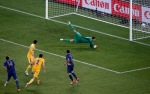 France's Jeremy Menez, left, scores the opening goal past Ukraine goalkeeper Andriy Pyatov, right, during the Euro 2012 soccer championship Group D match between Ukraine and France in Donetsk, Ukraine, Friday, June 15, 2012. (AP Photo/Vadim Ghirda)